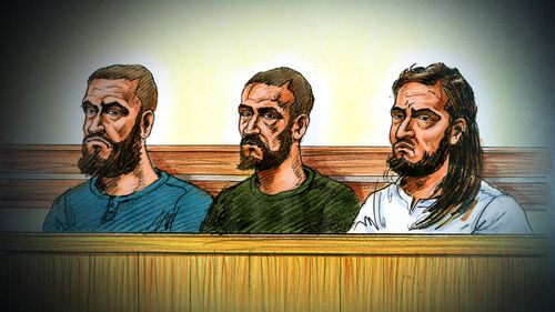 The three suspects in the dock at the Melbourne Magistrates' Court today.