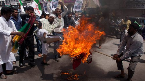 Indian Muslims burn an effigy of Myanmar's radical Buddhist monk Ashin Wirathu during a protest against the persecution of Myanmar's Rohingya Muslim minority. (AAP)