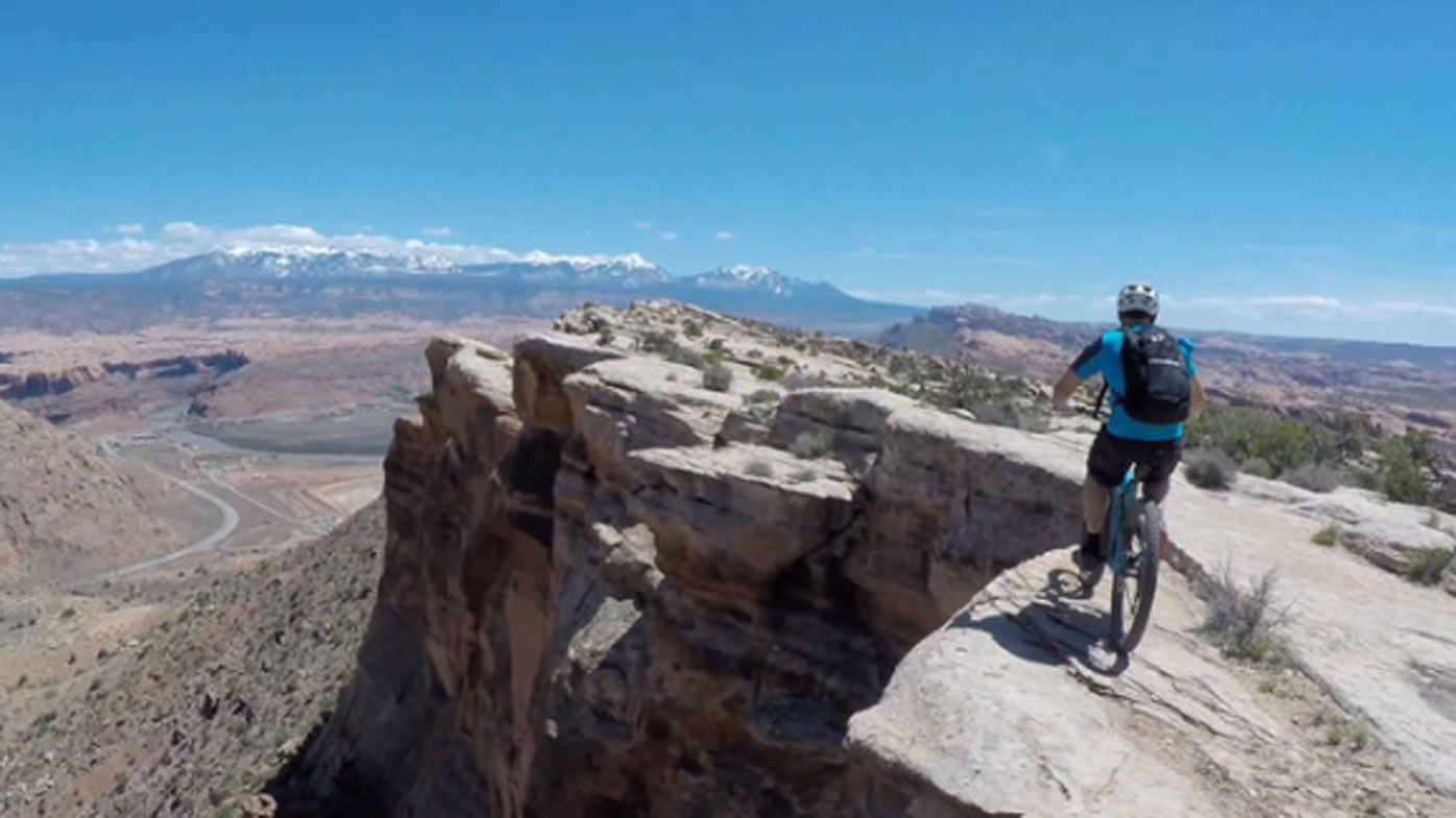 Mountain bikers risk life and limb on death-defying ride