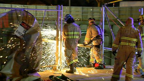 Emergency services had to winch one of the women from the site. (9NEWS)