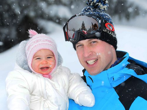 Prince William and Princess Charlotte on the family's first snow holiday. (AAP)