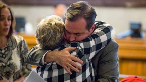 Cincinatti Mayor John Cranley hugs a member of Kyle Plush's family. (AP).