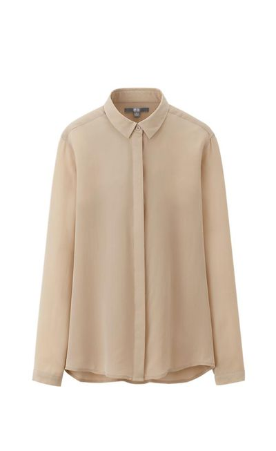"""<strong>#4 A wear-with-anything shirt</strong><br /><a href=""""http://www.uniqlo.com/au/store/w-s-silk-blouse-1283560010.html"""" target=""""_blank"""">Blouse, $79.90, Uniqlo</a>"""