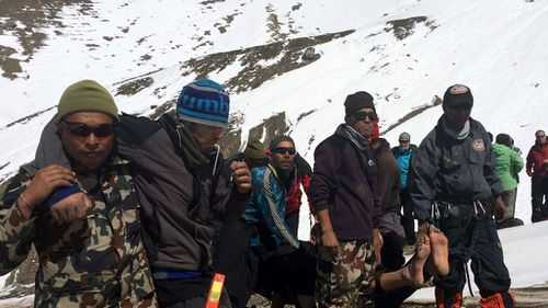 The Nepalese Army rescuing trekkers from the avalanche. (AAP)