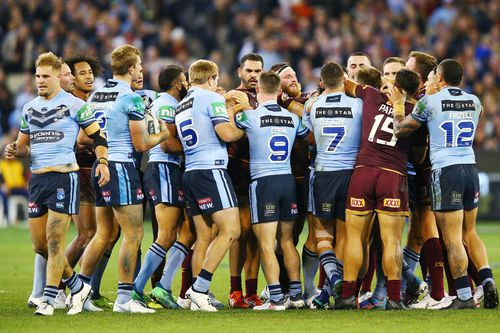 The series opener was as tight as State of Origin games that had come before - with all the scuffles, big hits and runs included. Picture: AAP.