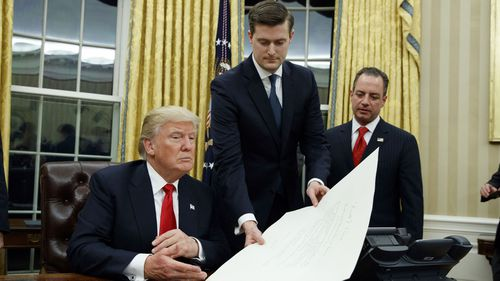 Donald Trump with Rob Porter and former chief-of-staff Reince Priebus. (AAP)