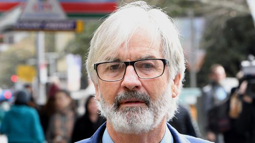 Australian actor John Jarratt arrives at the Downing Centre Local Court today.