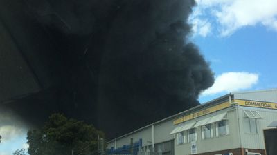 The factory complex appeared to be populated by single-level buildings. (9NEWS)