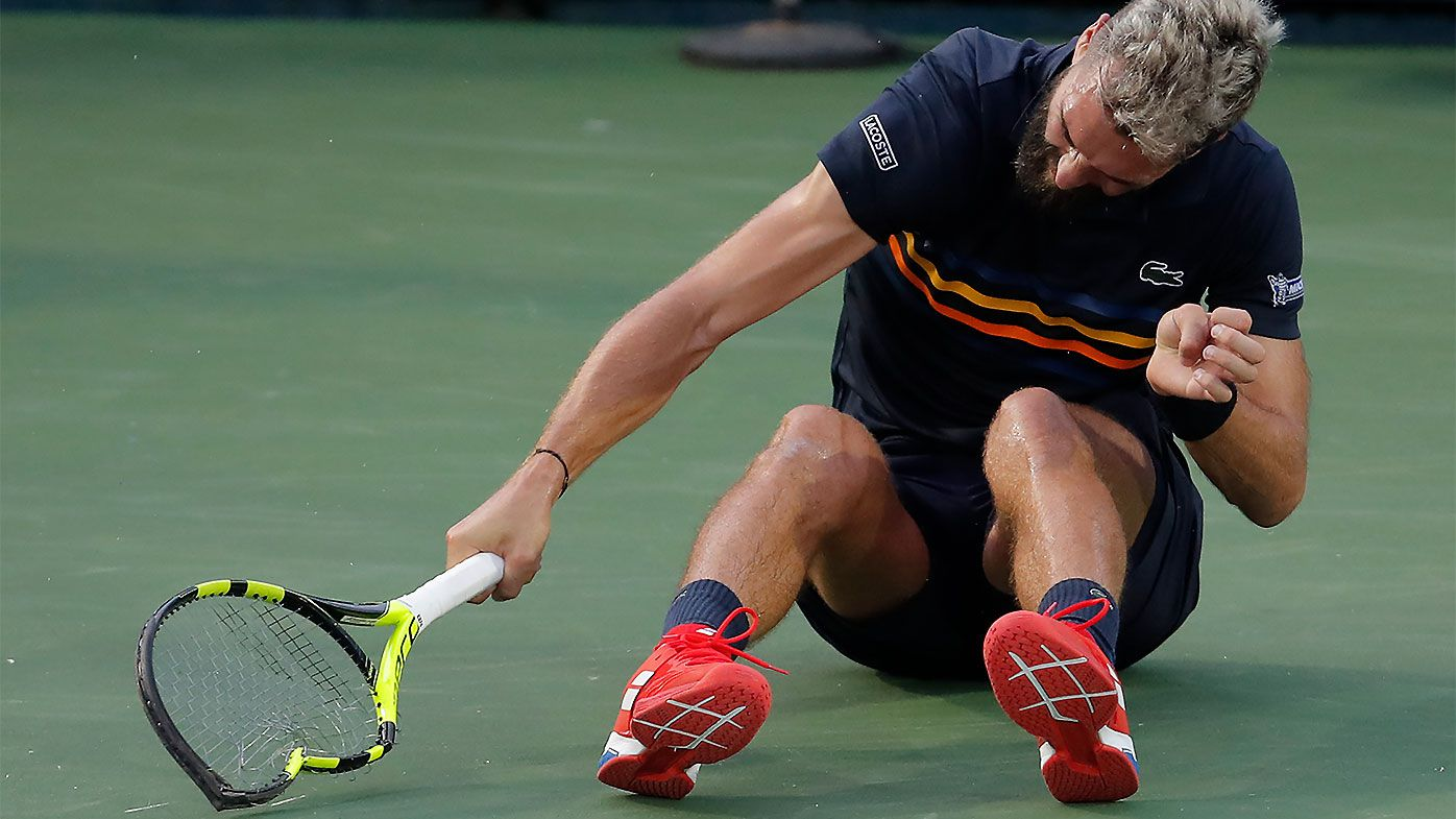 French tennis player spikes, throws, breaks rackets in loss