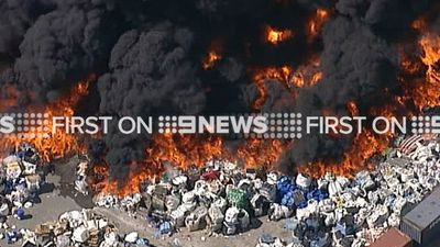 It is understood the fire started at a waste management facility in Lansvale. (9NEWS)
