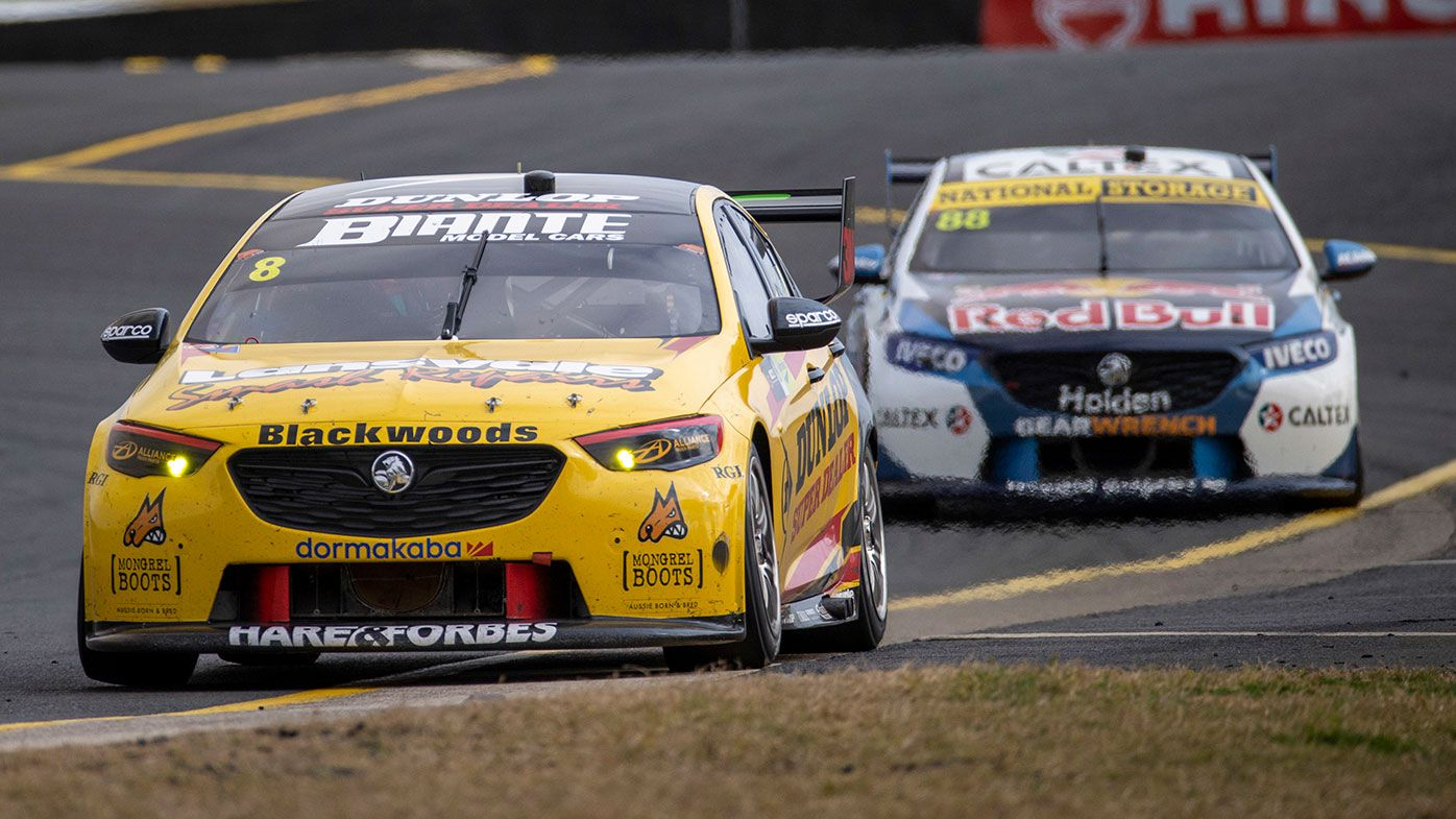 Nick Percat leads Jamie Whincup at Sydney Motorsport Park.