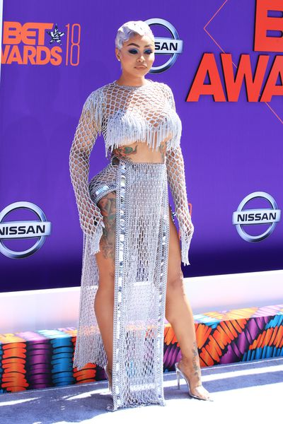 """<p>The A-list have walked the red carpet for the 2018 BET Awards, and as usual, they packed a serious sartorial punch.</p> <p>The ceremony, hosted by Jamie Foxx, will see performances by2 Chainz,Big Sean,and<a href=""""https://style.nine.com.au/2017/04/13/13/53/nicki-minaj-sheer-top-blur"""" target=""""_blank"""" draggable=""""false"""">NickiMinaj</a>, but we all know the real splash is always made on the red carpet.</p> <p>The stars opted for short hemlines, plunging necklines and sheer gowns to make sure they stood out.</p> <p>Blac Chyna turned heads in a silver fringed two-piece - complete with a serious side of underboob, <a href=""""https://style.nine.com.au/2016/11/22/10/34/victorias-secret-top-10/3"""" target=""""_blank"""" draggable=""""false"""">Trya Banks</a> dazzled in a sheer metallic jumpsuit by Stello, and<em>Love & Hip Hop</em>star Alexis Skyy made sure she'd be noticed in a completely sheer gown by Grayling Purnell.</p> <p>Take a look at the most talked about looks of the night…</p>"""