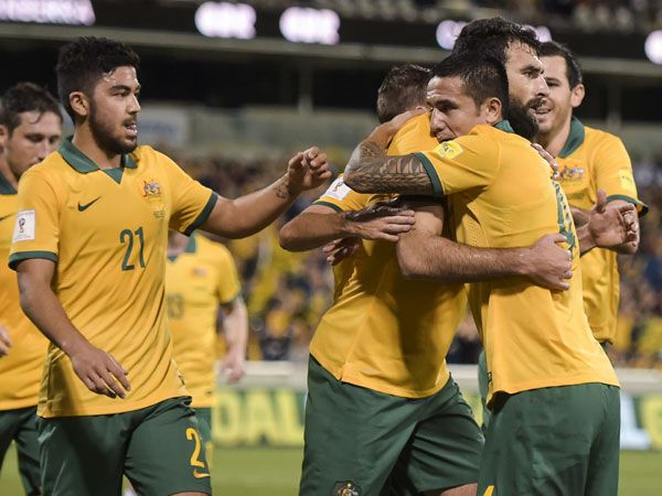 Socceroos captain Mile Jedinak (centre) celebrates with Tim Cahill after scoring against Kyrgyzstan. (AAP)