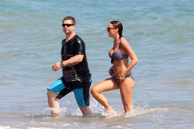 Jack Osbourne was snapped taking a dip in the Pacific Ocean with this mystery blonde