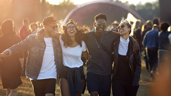 Friends hanging out at big music festival
