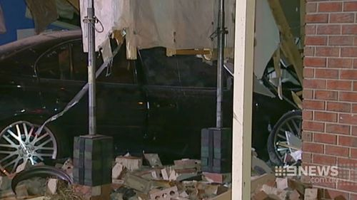 The car became airborne before it ploughed into the house. (9NEWS)