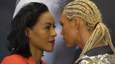 Female boxer Mikaela Lauren plants kiss on undefeated champion Cecilia Braekhus before title fight
