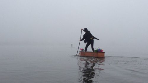 Who is the mystery undertaker paddling the fog shrouded waters of Lake Burley Griffin?
