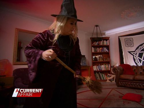Melbourne mum Lizzy Rose has found an unusual way of paying off her mortgage – by evicting demons from people's bodies.