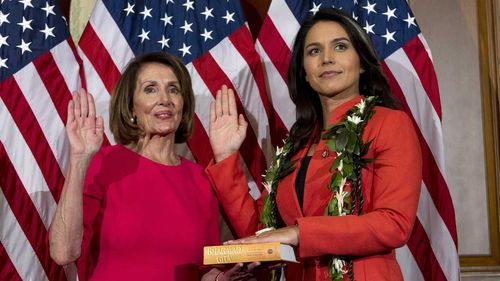 Tulsi Gabbard (right) is sworn into Congress by Speaker Nancy Pelosi.
