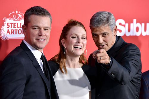 Matt Damon and George Clooney on the red carpet with Suburbicon co-star Julianne Moore. (AAP)