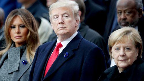 US President Donald Trump with First Lady Melania Trump and German Chancellor Angela Merkel.