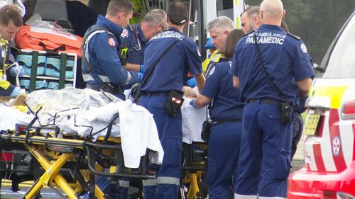 NSW Ambulance paramedics treat the injured man in Wyong.