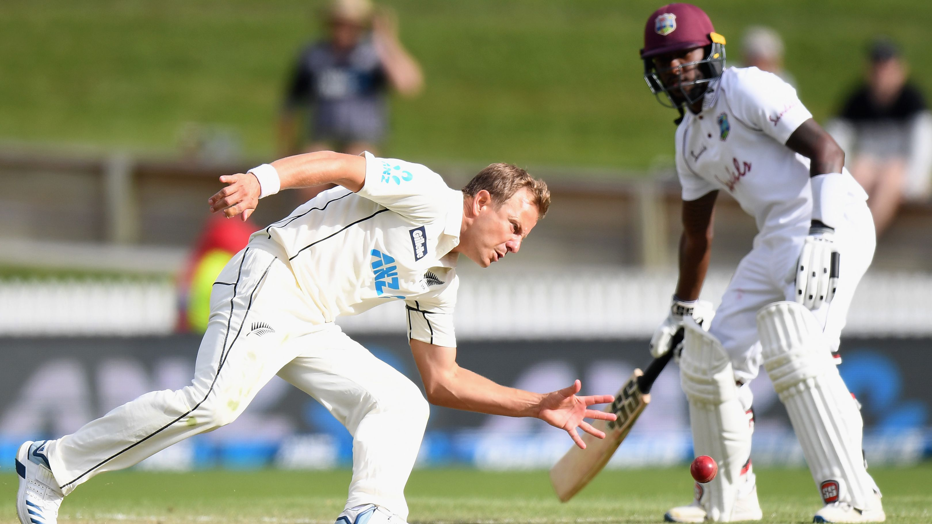 Neil Wagner of New Zealand fields the ball off his own bowling.