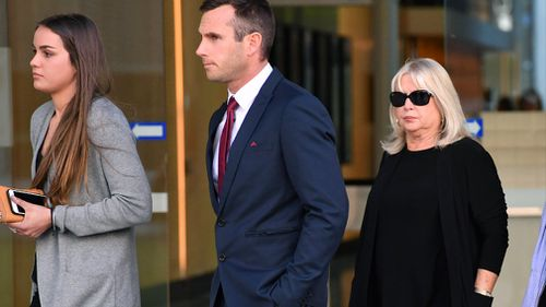 Witnesses Simon Gerbic (centre) and Cheryl Aiken (right) are seen leaving the Supreme Court in Brisbane. Picture: AAP