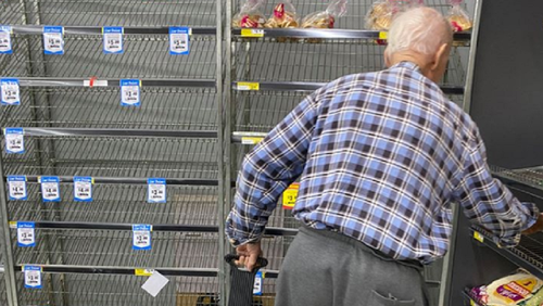 Man at IGA in Australia looking for bread.