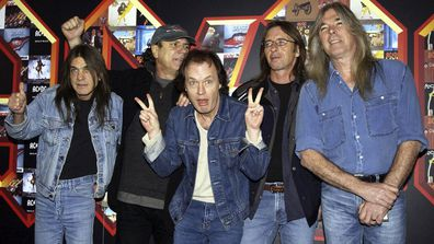 AC/DC pose for photographers at the Apollo Hammersmith in London from left: Malcolm Young, Brian Johnson, Angus Young, Phil Rudd and Cliff Williams (Photo: March 3, 2003)