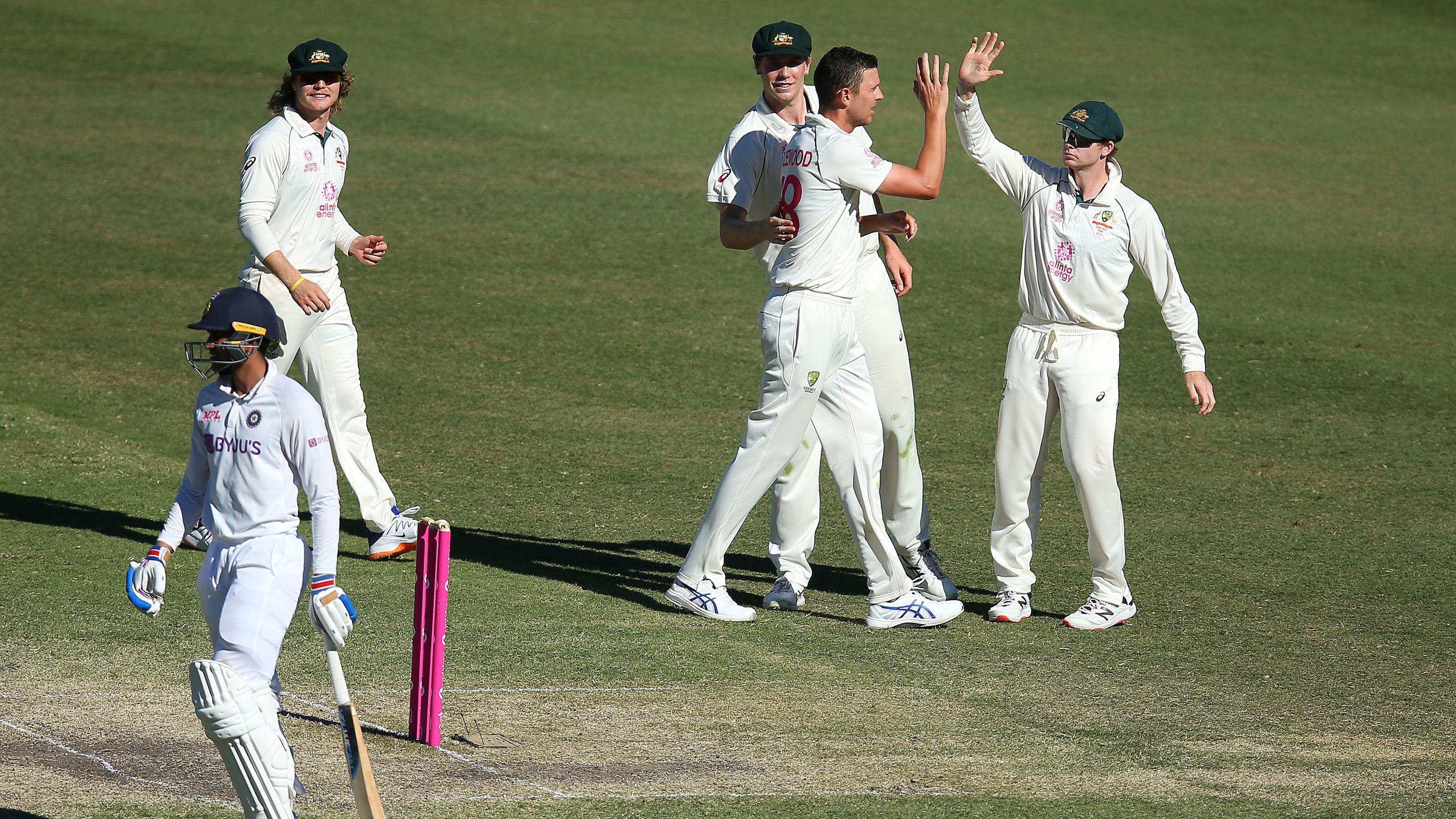Josh Hazlewood of Australia celebrates after taking the wicket of Shubman Gill of India.