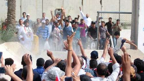 Iraqi protesters breached a concrete wall to enter the Green Zone. (AFP)