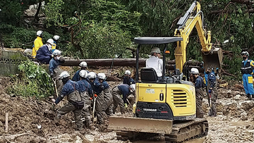 Firefighters search for missing people following heavy rain in an area in the Obama neighbourhood of Unzen, Nagasaki prefecture, southern Japan.