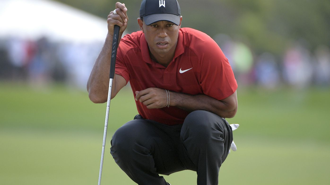 Tiger Woods watches putt