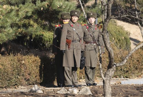 North Korean soldiers look at the South side at the spot where a North Korean soldier crossed the border. (AAP)