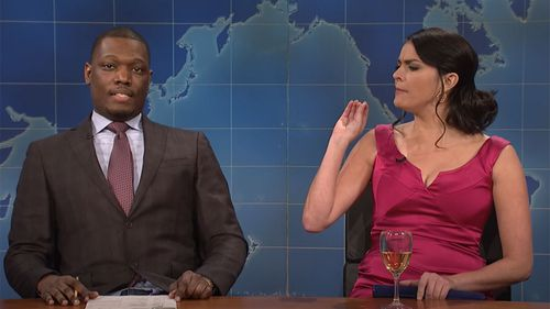 Cecily Strong playing 'Girl you wish you hadn't started a conversation with at a party' on Saturday Night Live, alongside Weekend Update anchor Michael Che.