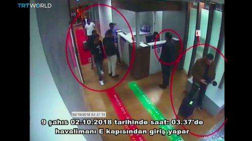 "This image taken from a surveillance camera shows people inside Ataturk International Airport, Istanbul, Turkey, on Oct. 2, 2018. The text in Turkish reads: ""nine people enter from airport's E Gate on October 2, 2018 around 03:37."""