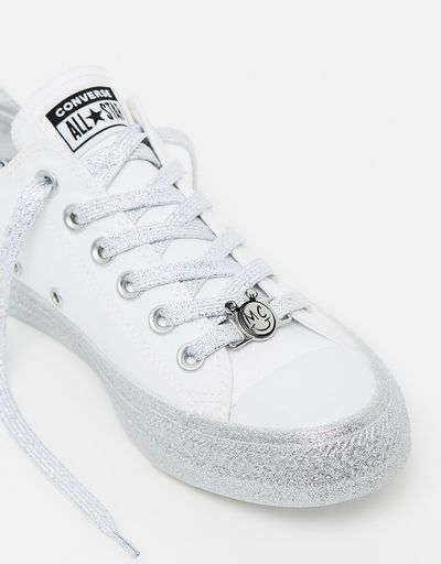 "<a href=""https://www.theiconic.com.au/converse-x-miley-chuck-taylor-all-star-classic-632667.html"" target=""_blank"">Converse X Miley Chuck Taylor All Star Classic in White, $120</a>"