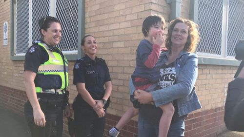 The boy and his mother were reunited at a police station. (Twitter / @NearyTy_9)