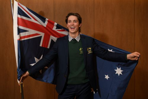 Australian halfpipe snowboarder Scotty James poses for a photograph with the Australian flag after being announced as the team flag bearer. (AAP)