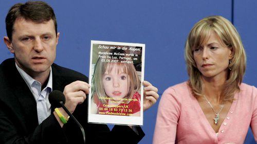 Gerry and Kate McCann, parents of Madeleine who disappeared while on holiday in Portugal in May 2007, show a picture of their daughter at a June 2007 press conference in Berlin, Germany.