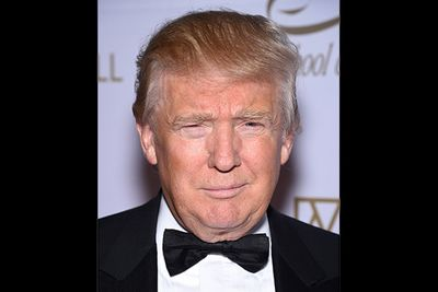 """You gotta love Donald Trump's shameless vanity. Fake hair, don't care! Fake tan… bring it on, man! We can't help but wonder what the 68-year-old business tycoon actually looks like under all that stuff. Ugh… Now that's a bizarre mental image you'll need """"fired"""" from your mind immediately. Sorry about that."""