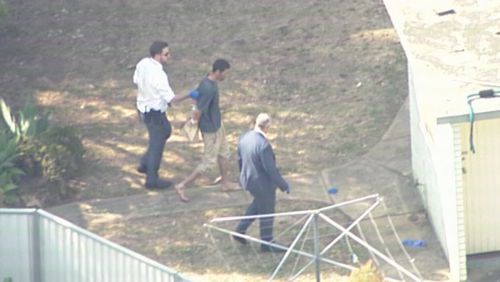 A man was led away from the scene by detectives.