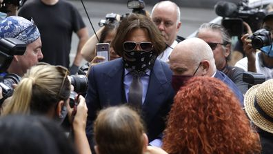Actor Johnny Depp is surrounded by fans and the media as he arrives at the High Court in London, Friday, July 17, 2020.
