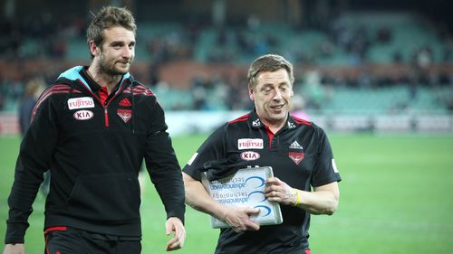 Thompson (right) coached Essendon until 2014. (AAP)