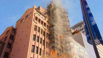 Lockhard Chambers on Macquarie Street erupted in flames only days after its cladding was removed.