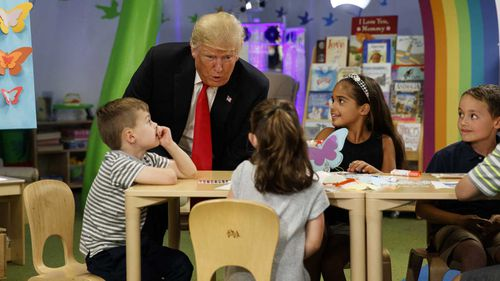 President Donald Trump talks with a group of children during a visit the Nationwide Children's Hospital.