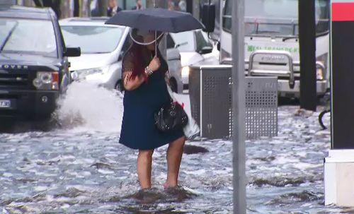 People were left standing in flowing water as the rain hit.