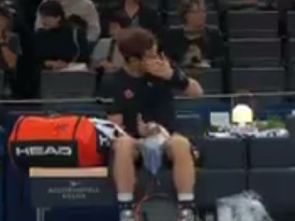 Andy Murray reacts after a ball girl throws a ball at him and knocks his drink bottle out of his hand. (Supplied)